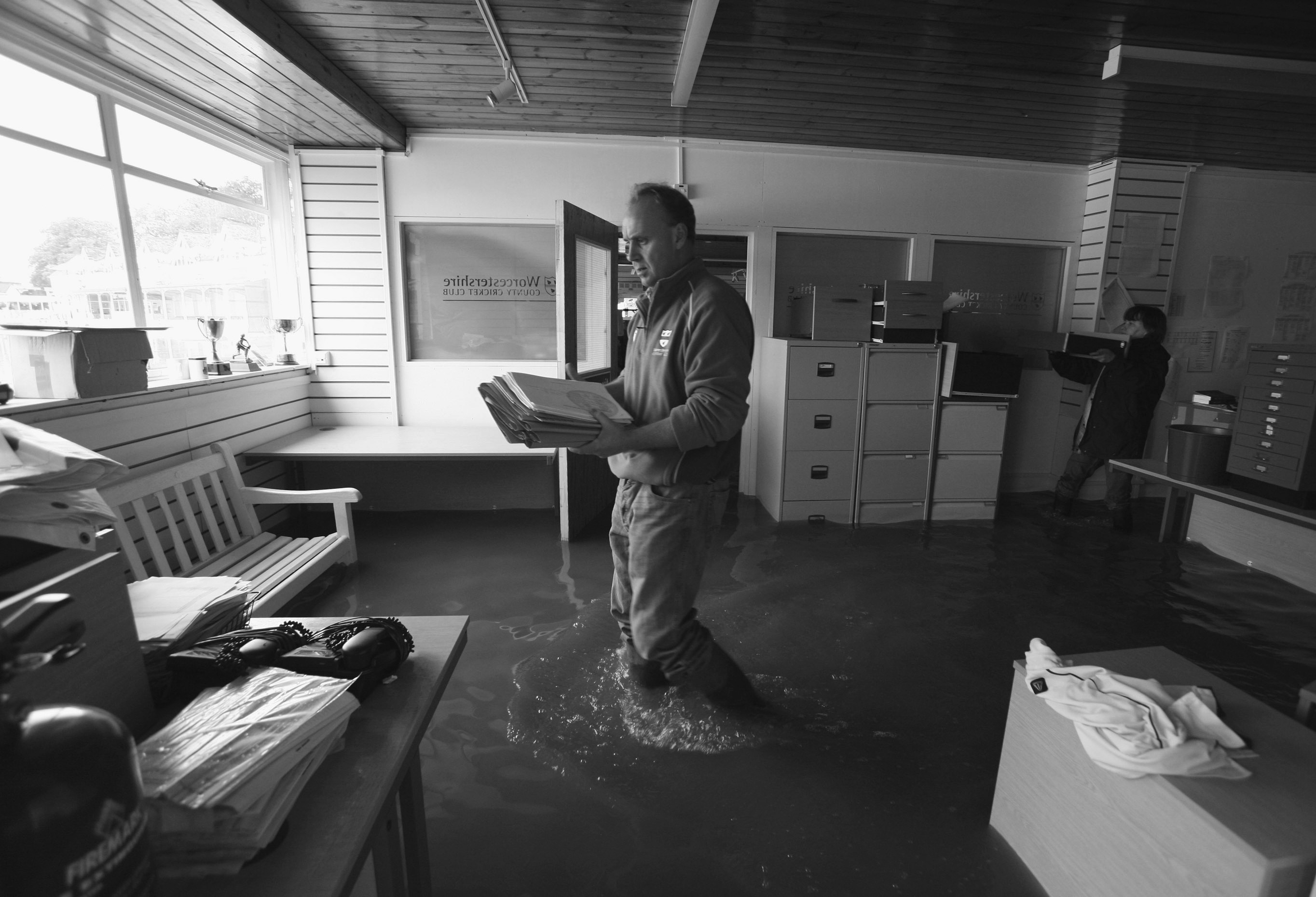 man clearing up after a flood