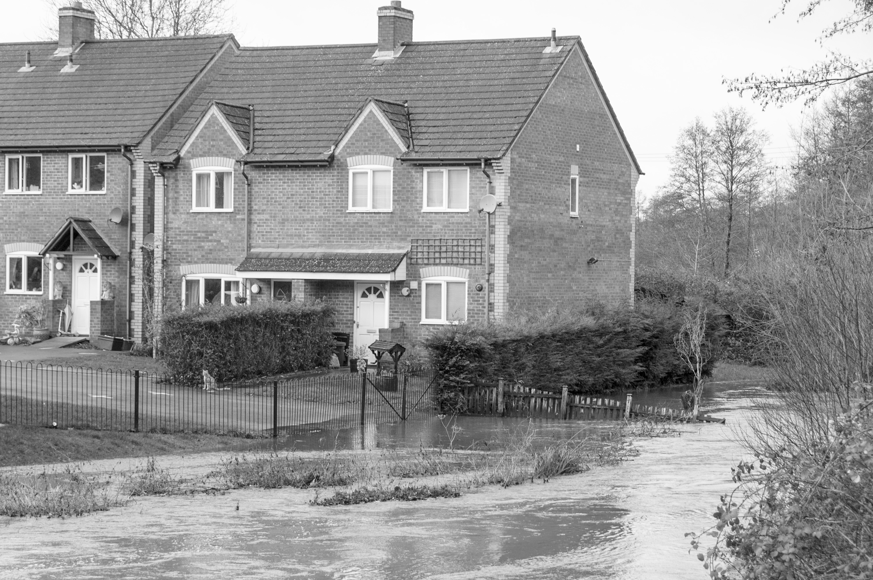 Rising flood waters threaten homes in Gloucestershire in the UK