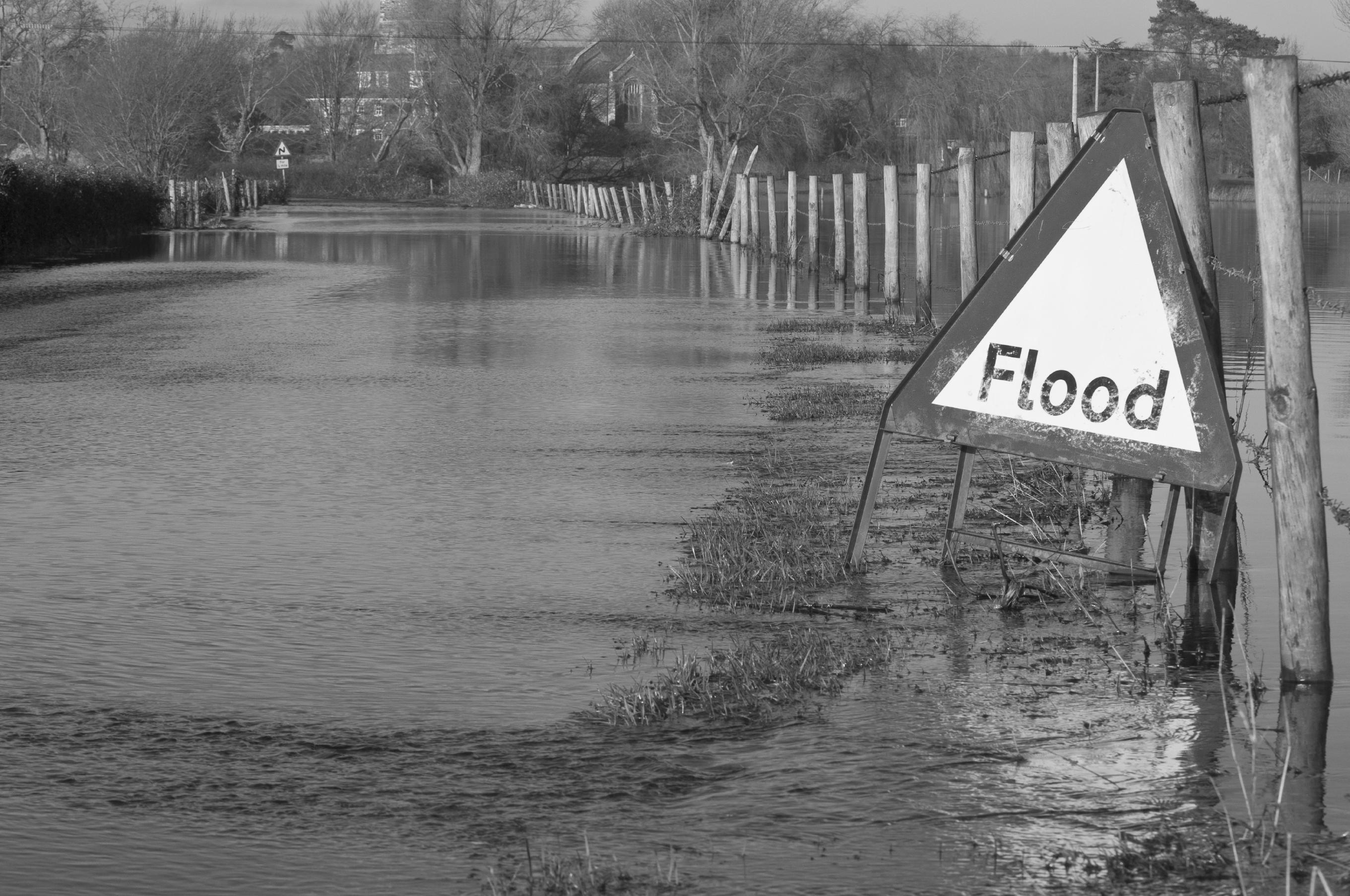 Flood sign where UK river burst its banks